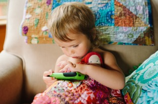baby-playing-with-device
